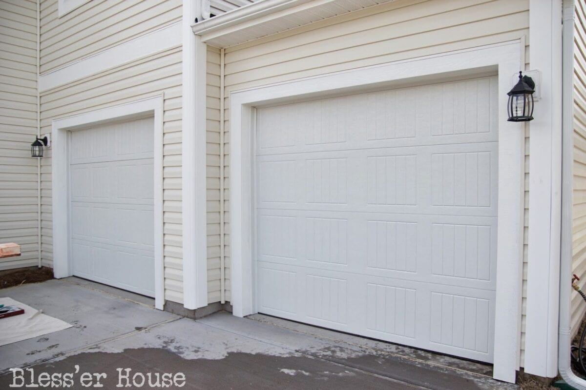 Carriage doors carriage house garage door via for Build carriage garage doors