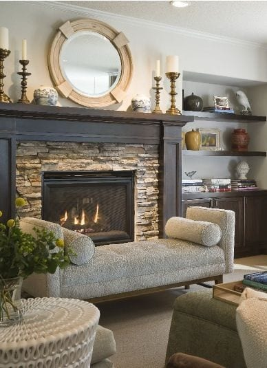 Stacked stone fireplace surround with wood mantle  |  Andrea's Innovative Interiors - Andrea's Blog - Warm up by theFire