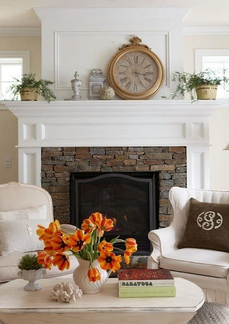 Keep molding/casing around fireplace but maybe replace the tiles with a stacked stone wall tile to cut cost on demo and install.