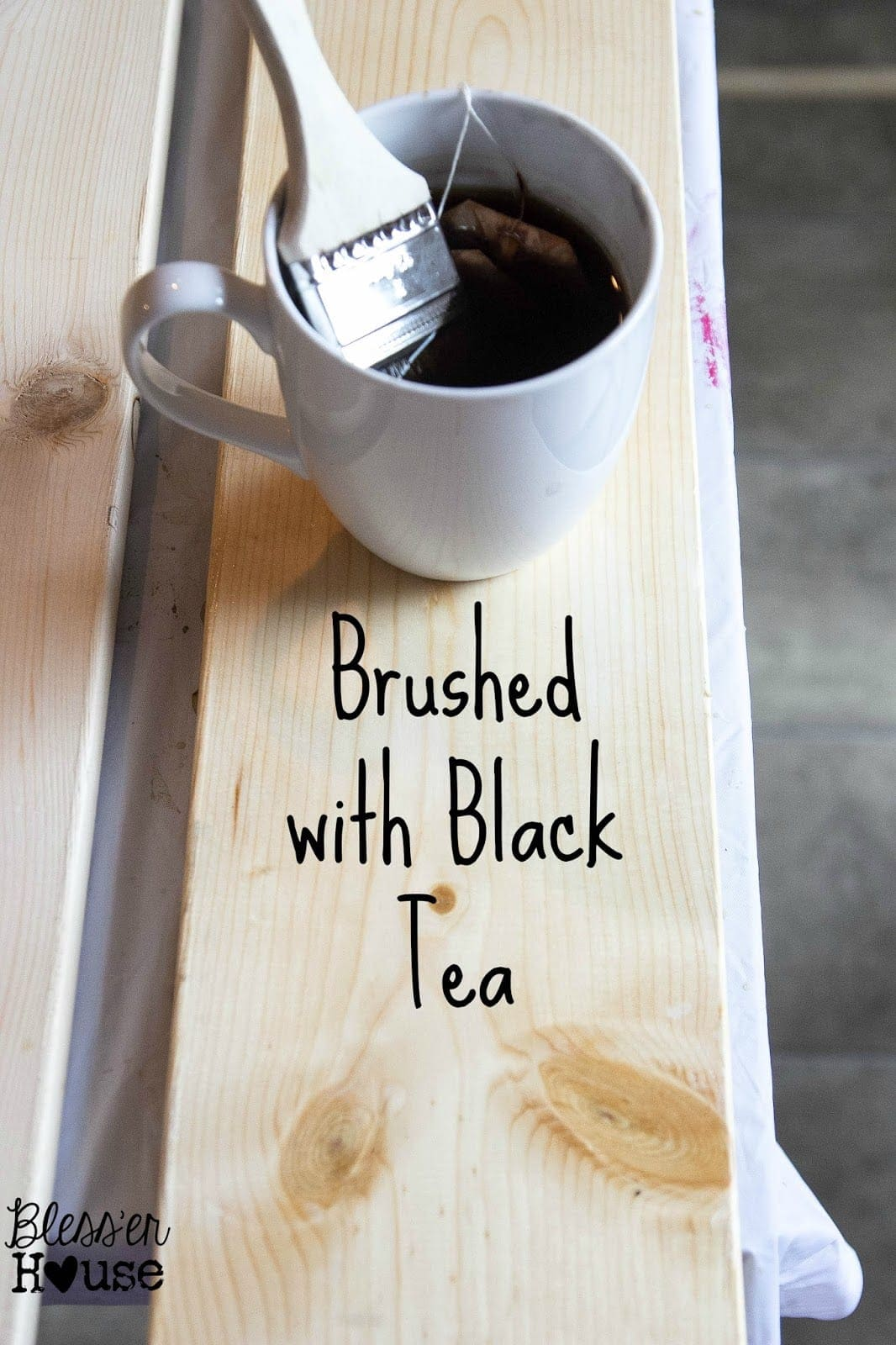 The first step in this all natural wood stain method is to brush the lumber with the black tea, steeped for over 24 hours.