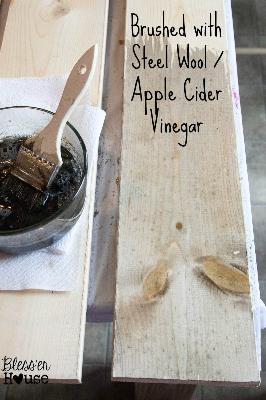 The next step in this all natural wood stain method is to brush the tea stained lumber with the steel wool and apple cider vinegar stain.