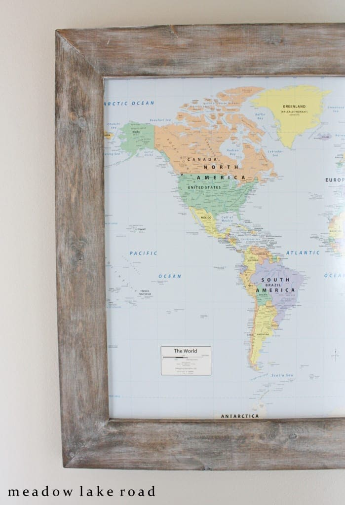 framed world map in hallway