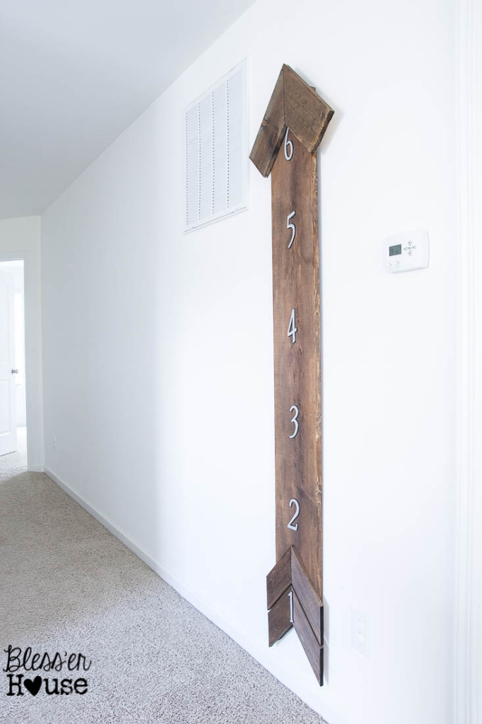 DIY Rustic Arrow Growth Chart | Bless'er House - Cute twist on the oversized ruler ones!