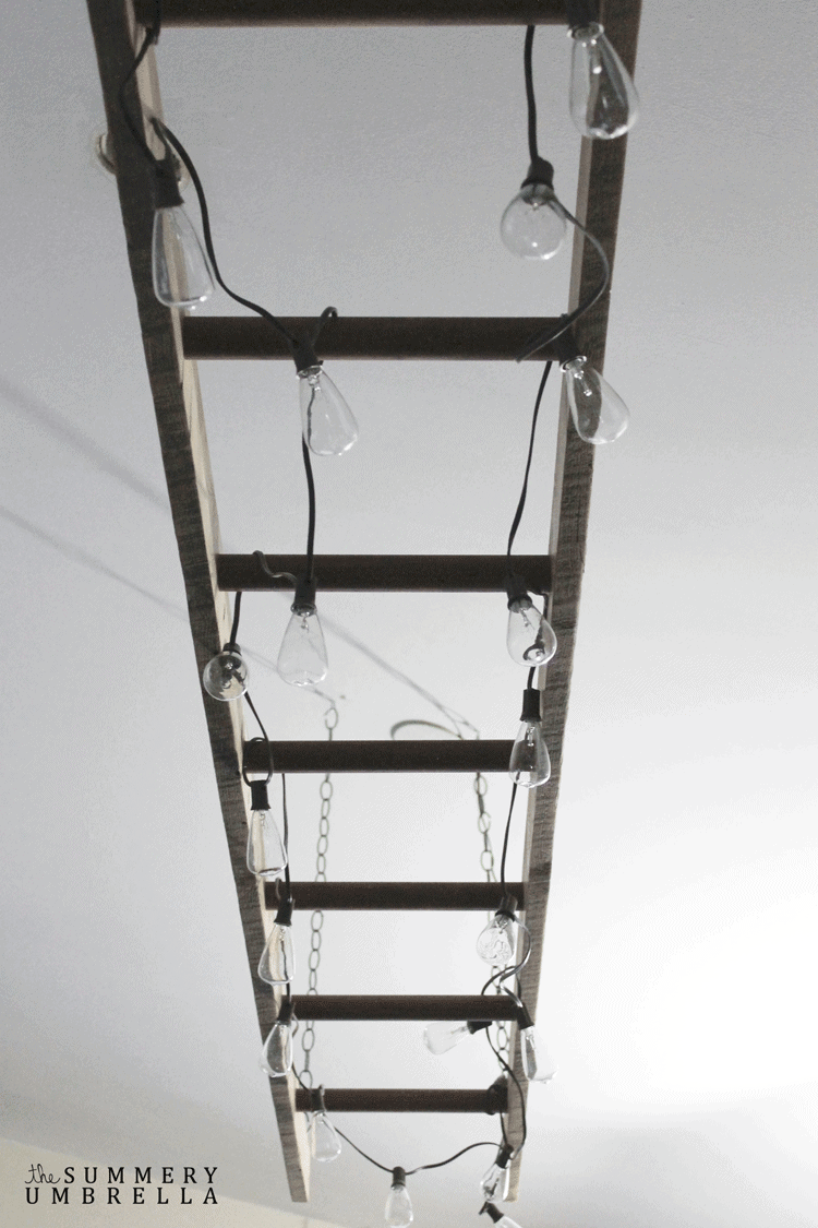 DIY Ladder Light | The Summery Umbrella for Bless'er House - This is such a unique idea!