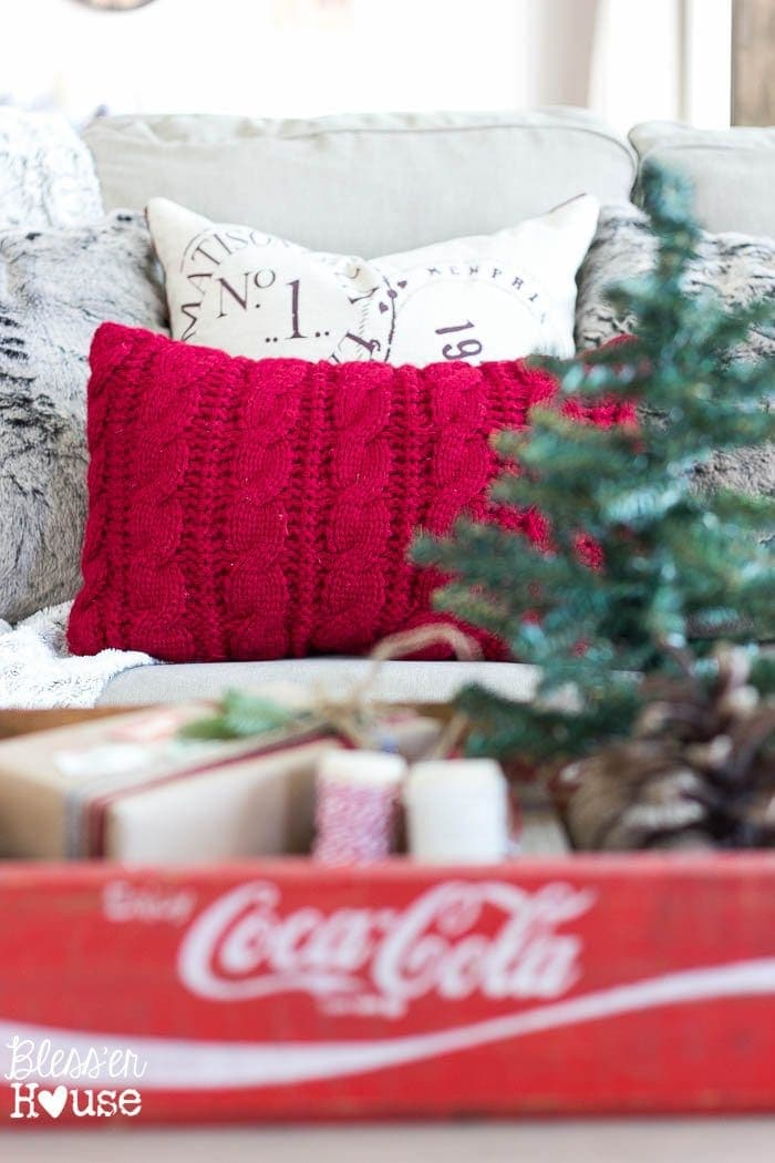 Thrifty Christmas decorating idea: reuse old sweaters to make throw pillow covers