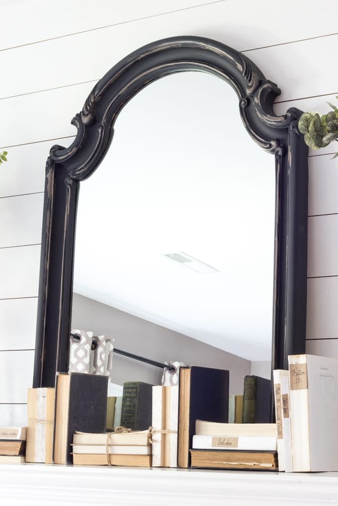 Distressed Charcoal Scroll Mirror Makeover | blesserhouse.com - How to distress non-wood materials without sanding using Vaseline. This is smart! The lazy girl's way to distress. ;)