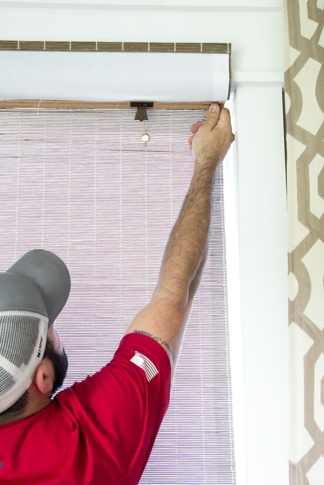 The Best Way to Make a Big Statement With Window Decor | blesserhouse.com - A living room gets a window decor makeover with DIY Craftsman window trim, long white curtains, and natural woven shades from Blinds.com #sponsored