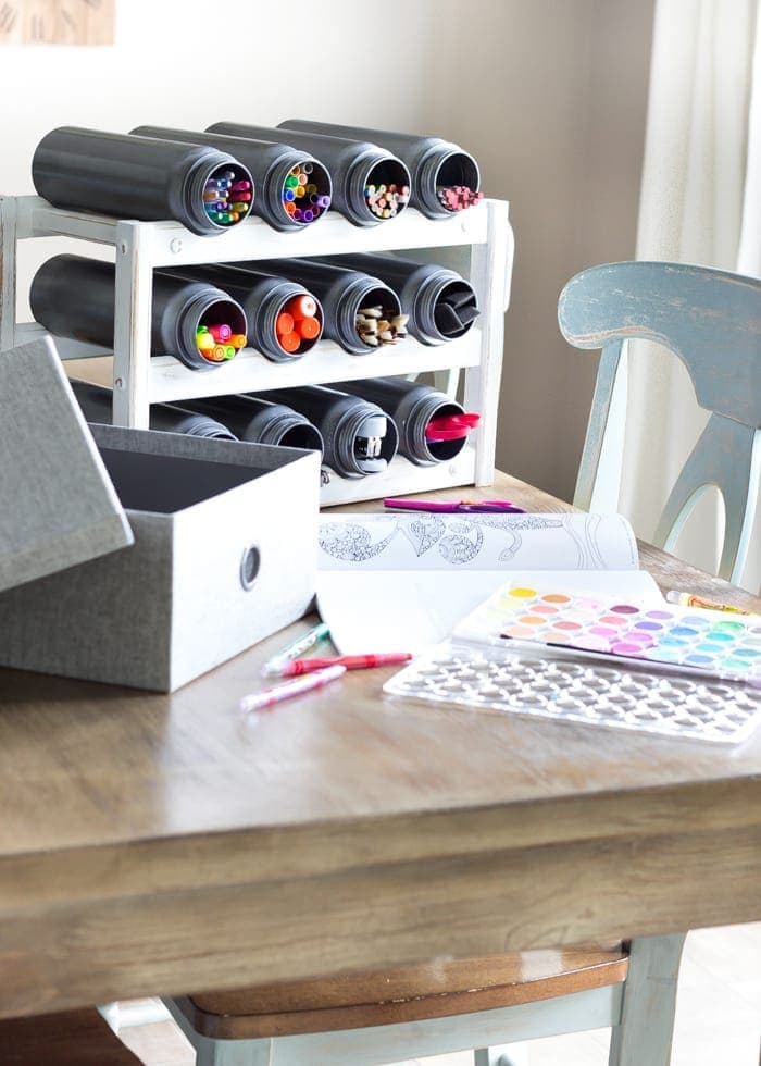 Easy Wine Rack School Supply Organizer | blesserhouse.com = How to turn an old castoff wine rack into a school supply organizer in minutes with just paint and a quick trip to the dollar store.