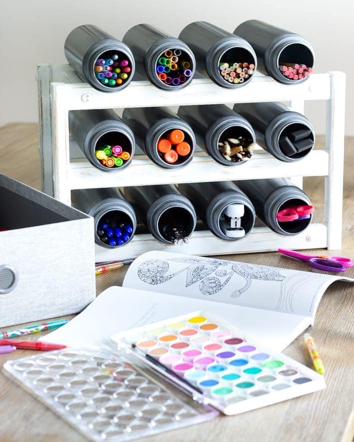 Easy Wine Rack School Supply Organizer   blesserhouse.com = How to turn an old castoff wine rack into a school supply organizer in minutes with just paint and a quick trip to the dollar store.