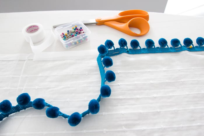 DIY No-Sew Pom Pom Curtains   How to make DIY no-sew pom pom curtains in an hour and for $100 cheaper than Pottery Barn & Anthropologie for a playful vibe in any room.