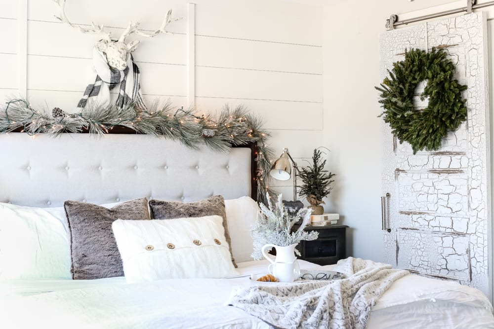 White Christmas Bedrooms | blesserhouse.com - A winter white Christmas bedroom tour with soft neutrals, frosted greenery, mercury glass, and candlelight plus 17 more blogger holiday homes in the All Through the House Tour.
