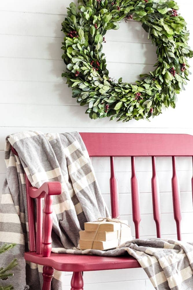 A quick and simple bench makeover using Cranberry Fusion Mineral Paint in one easy step for a festive farmhouse style Christmas entryway.