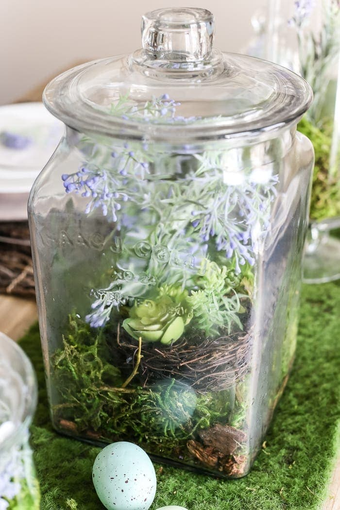 Apothecary Jar Terrarium Easter Centerpiece   blesserhouse.com - An apothecary jar terrarium Easter centerpiece and tablescape for a vintage style look with a budget-friendly price tag, plus more Easter entertaining ideas