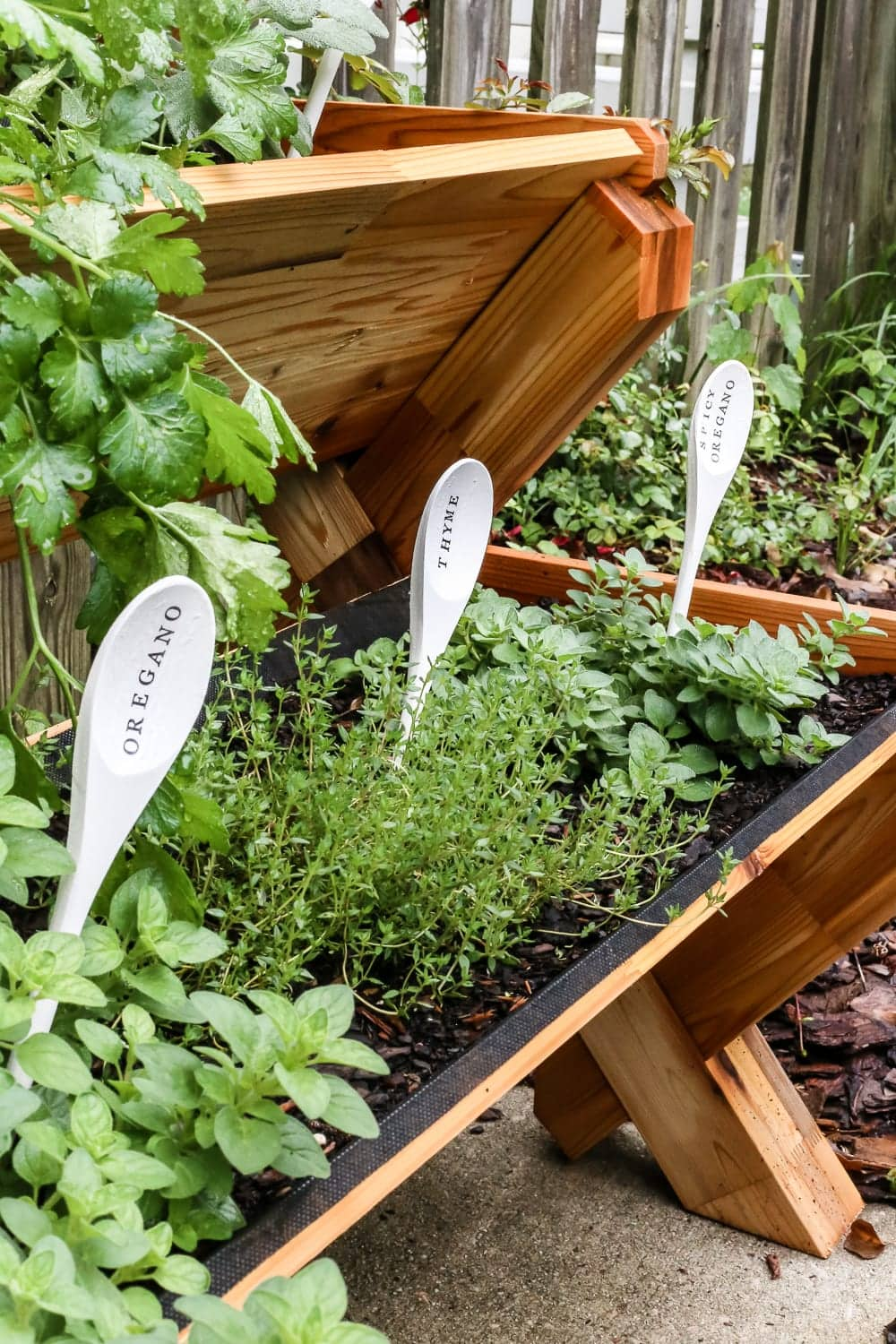DIY Wooden Spoon Garden Markers | blesserhouse.com - A simple tutorial for how to craft your own vintage-inspired garden markers made from wooden spoons, plus a resource for a beautiful stacked herb garden.