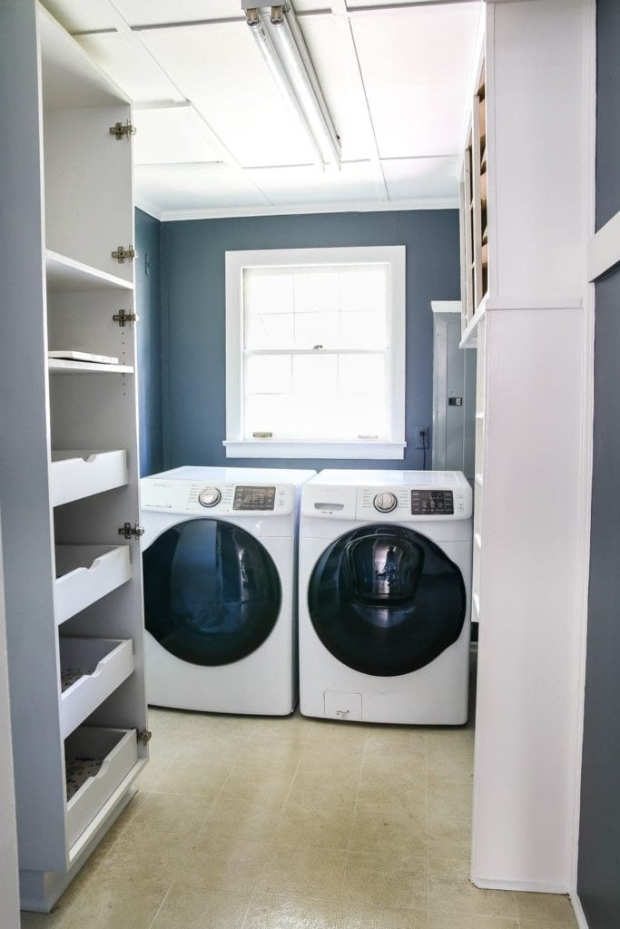 Navy and White Laundry Room Design Plans   blesserhouse.com - A laundry room design plan mood board featuring deep blues, bright whites, and vintage-inspired storage solutions on a tight budget.