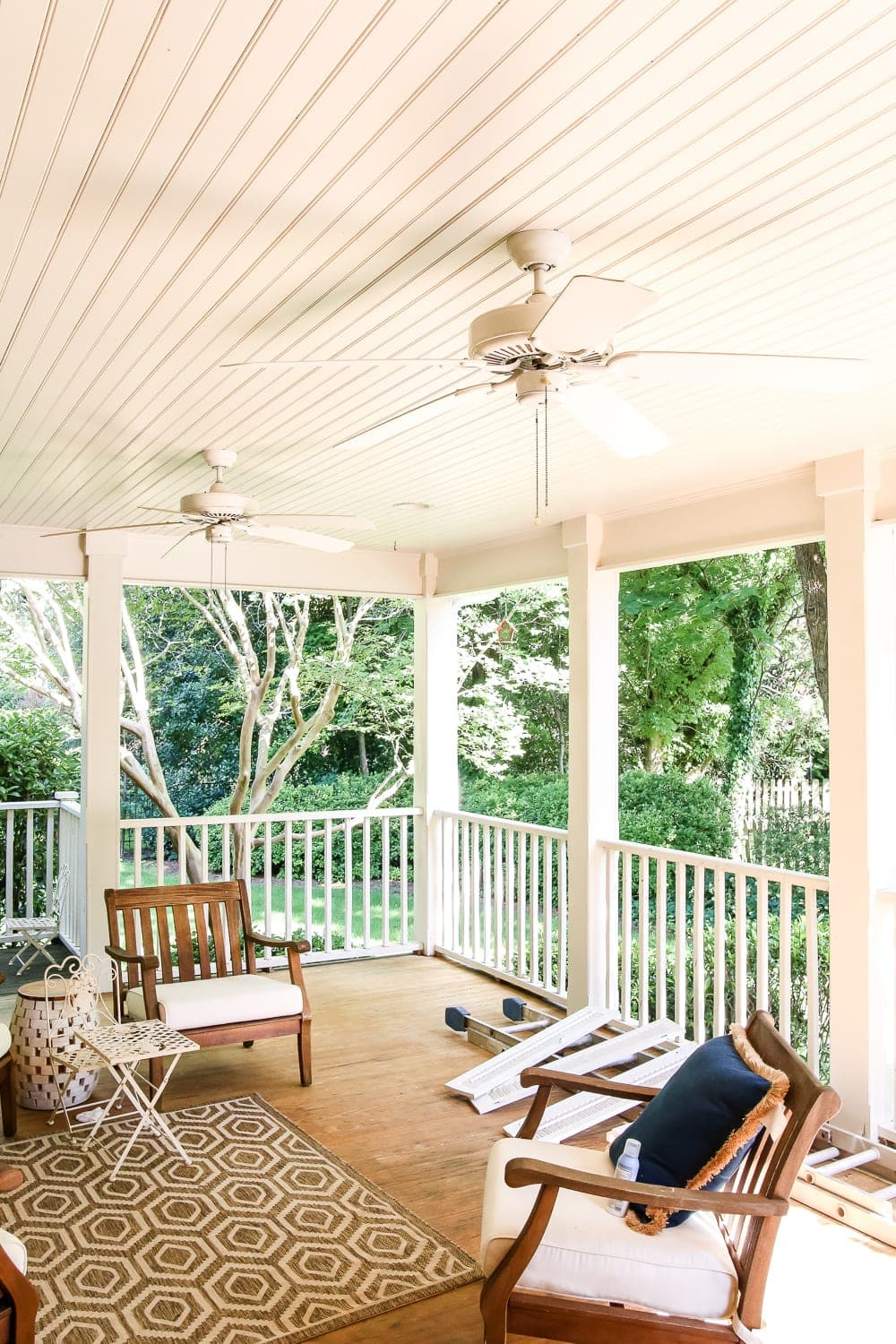 "Haint Blue Porch Ceiling Makeover | blesserhouse.com - A drab, beige porch gets a fresh, Southern makeover with ""haint"" blue (Benjamin Moore Palladian Blue) and modern farmhouse ceiling fans."