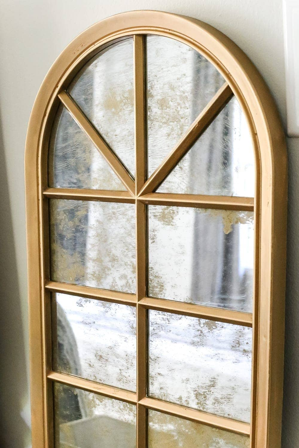 DIY Aged Gold Antique Mirror Makeover | blesserhouse.com - A DIY tutorial to transform a cheap, plastic mirror to look like an Anthropologie inspired aged gold antique mirror using Rub 'n Buff.