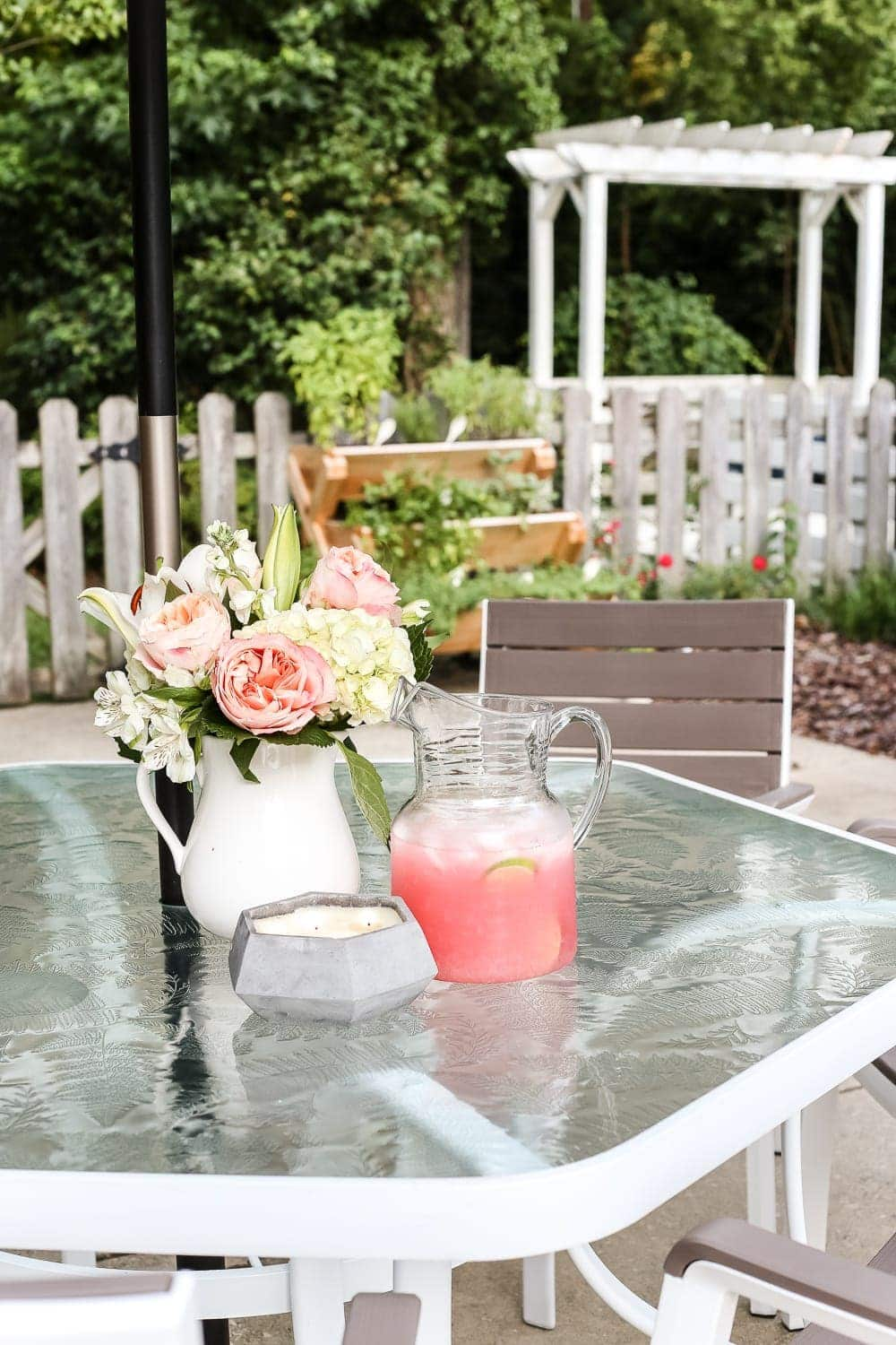 How to Revive a Glass Patio Table | blesserhouse.com - A tutorial explaining how to clean, paint, and revive a glass patio table to make it look brand new in a few quick steps.