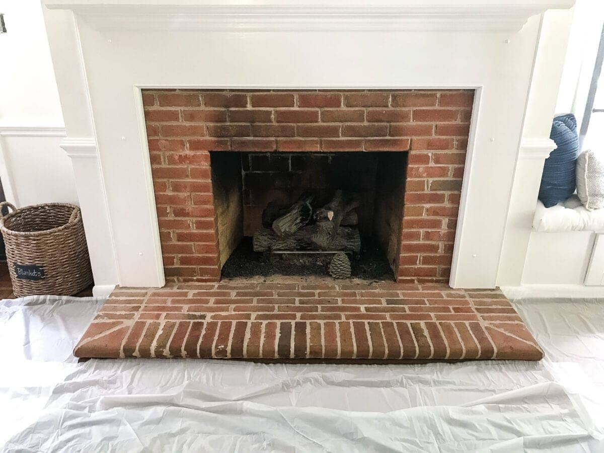 A dirty and tired orange brick fireplace gets a brightened up