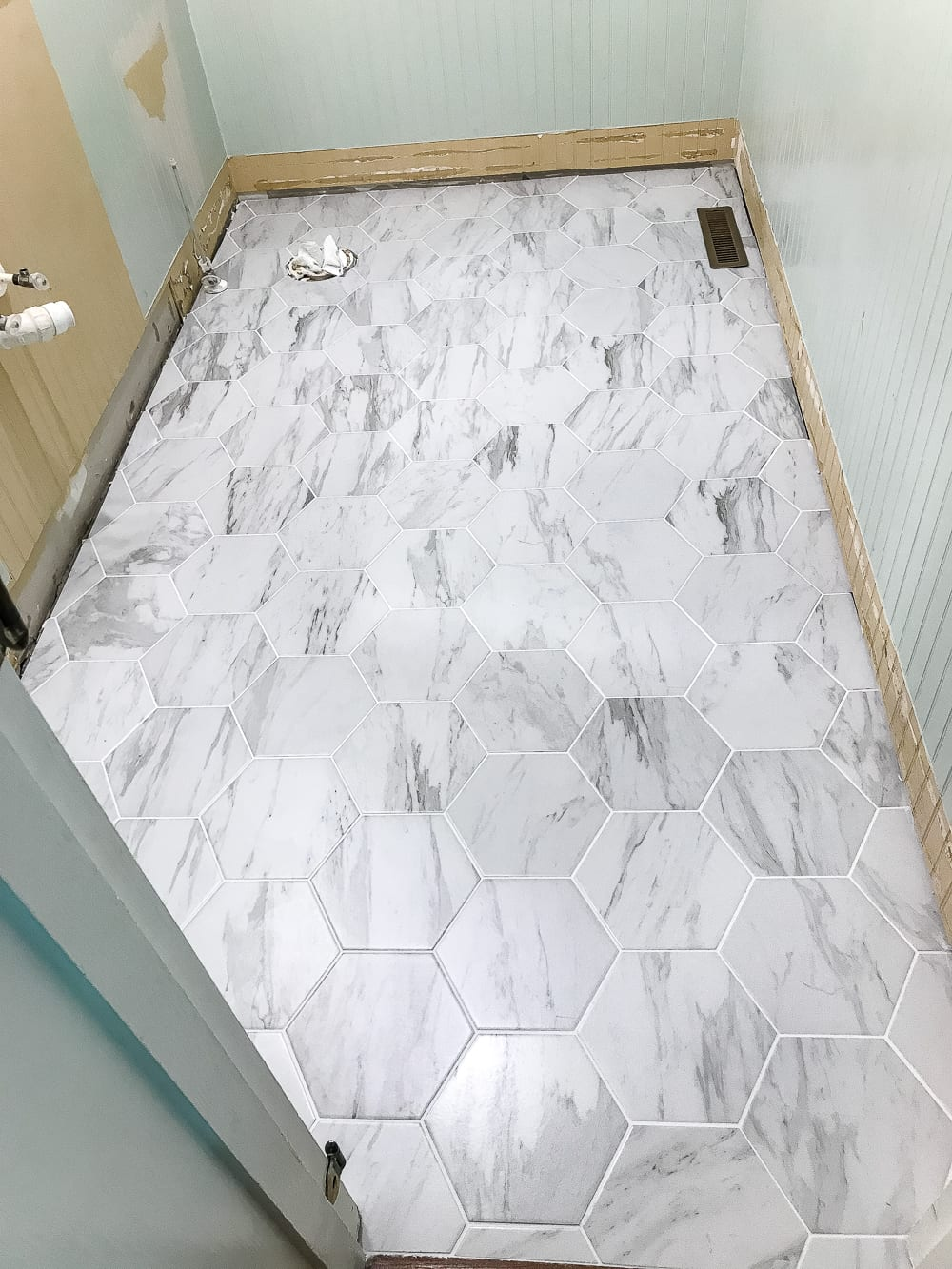 Powder room makeover faux marble tile floor bless 39 er house for Fake tile floor