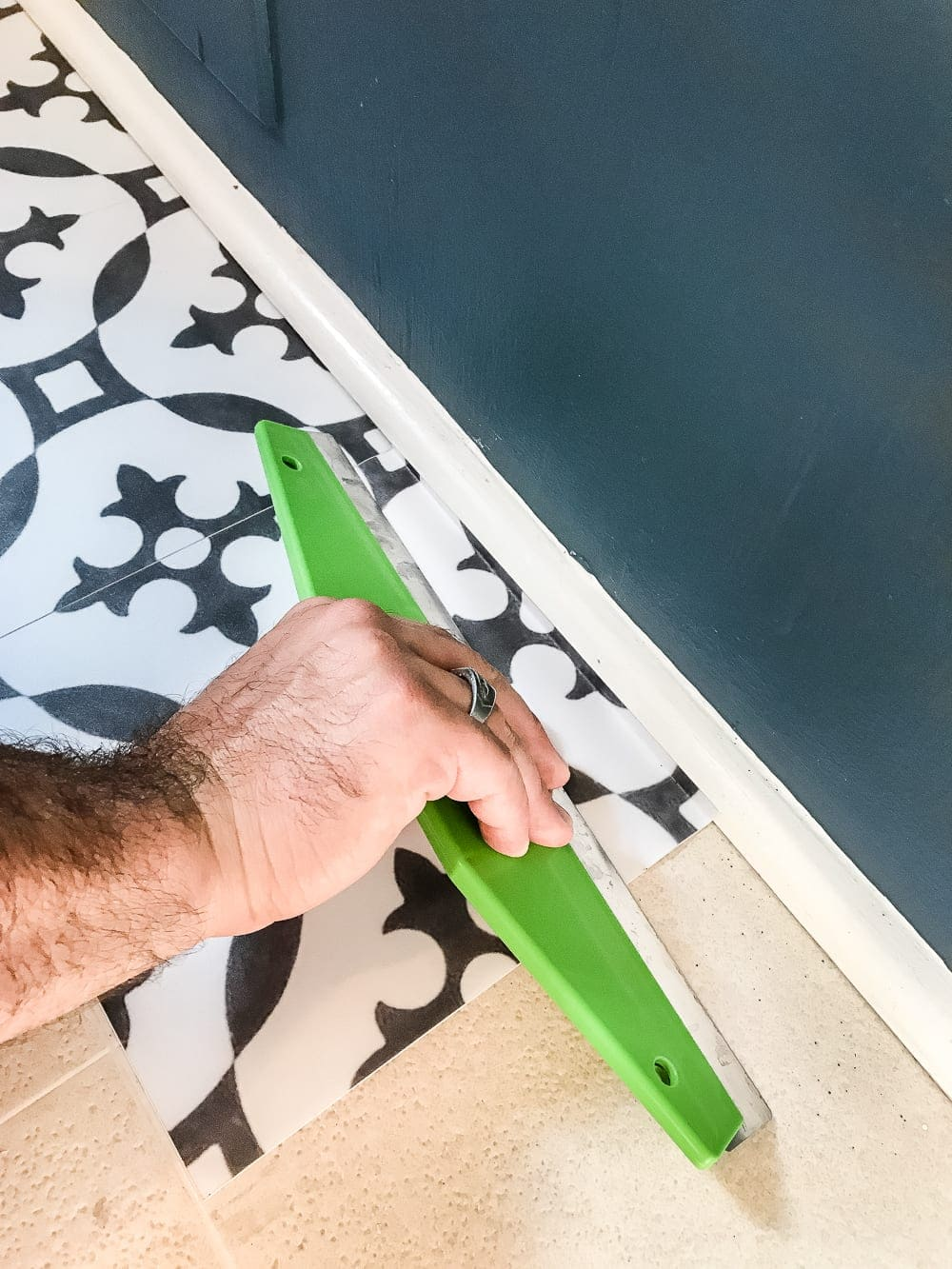 DIY Moroccan Vinyl Tile Floor | blesserhouse.com- A DIY tutorial for how to install moroccan peel & stick vinyl tiles. Less messy than paint. Less time-consuming and less expensive than real tile!