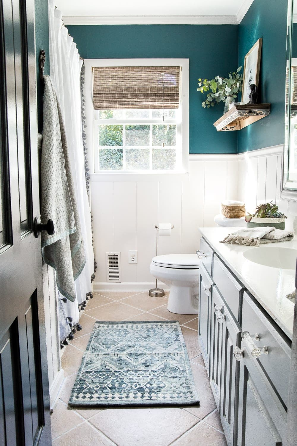 teal and white bathroom