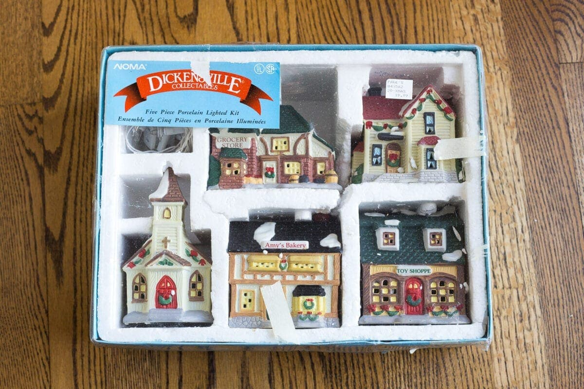 How to turn an old Christmas village figurine set and dome clocks into a snow globe inspired centerpiece. #Christmasdecor #ChristmasTable #ChristmasCenterpiece
