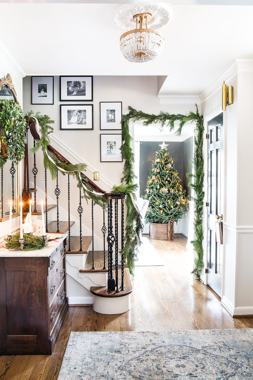 Classic Christmas Foyer | blesserhouse.com - A classic traditional entryway / foyer decorated for Christmas using fresh pine and holly greenery and a St. Lucia Day Advent wreath. #christmasfoyer #classicdecor #traditionalchristmas
