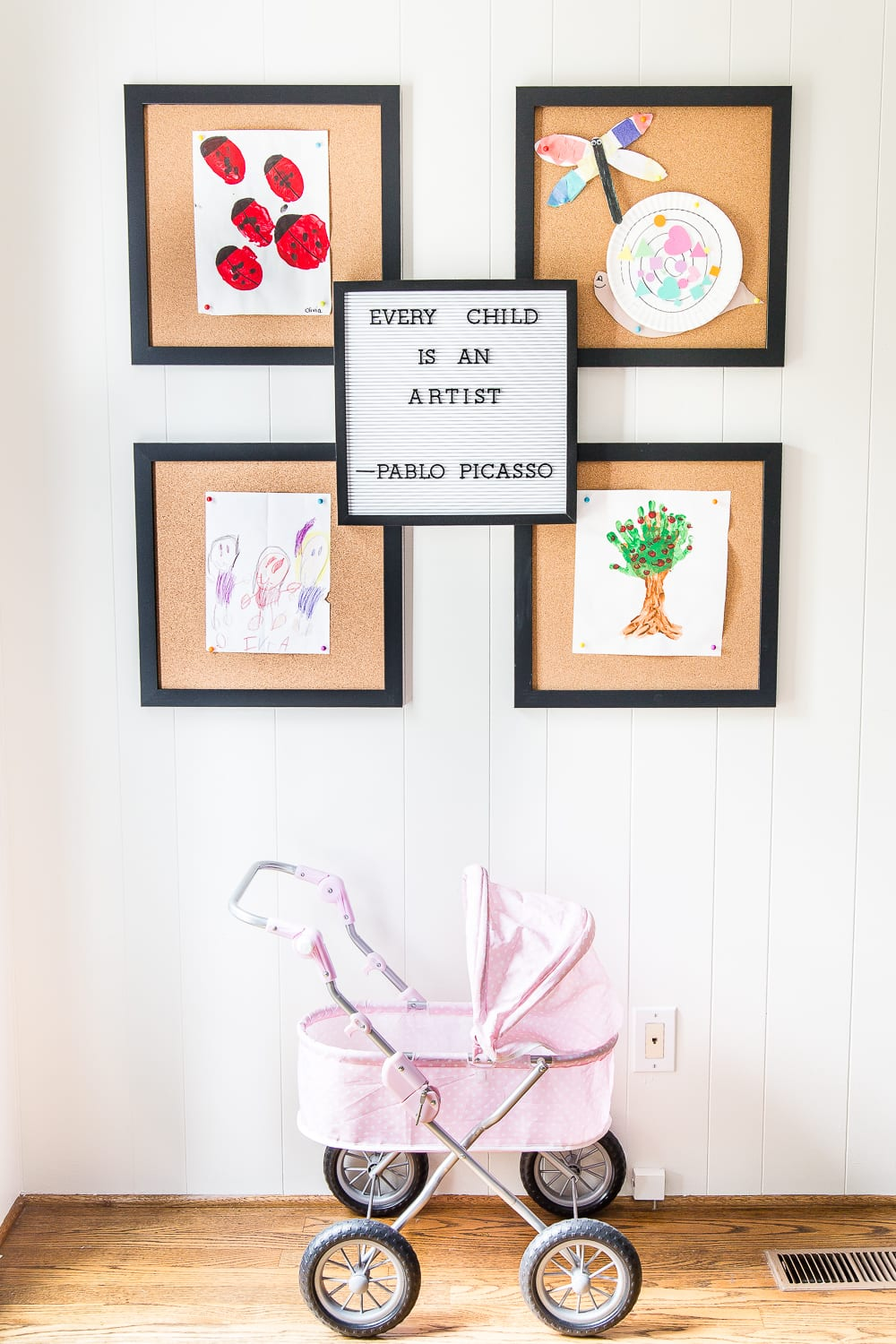 kid-friendly home - art display in playroom
