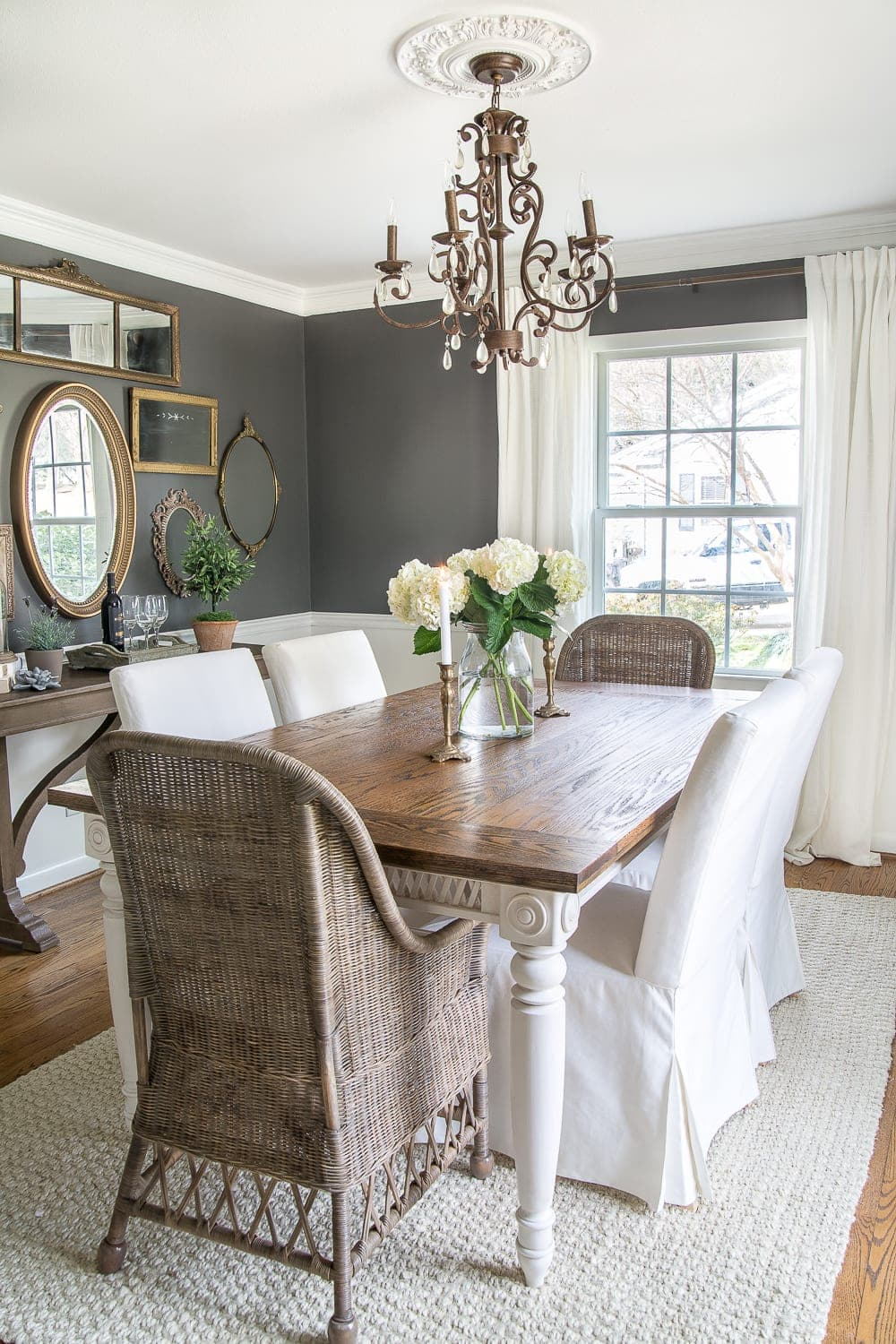 Dark charcoal dining room with woods and whites