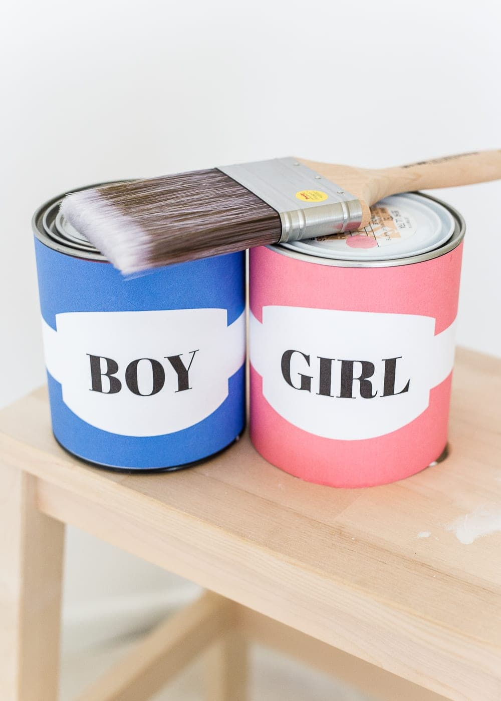 A gender reveal photo shoot using wall paint for the nursery. #genderreveal #heorshe #boyorgirl #nursery #genderphotoshoot #DIYgenderreveal