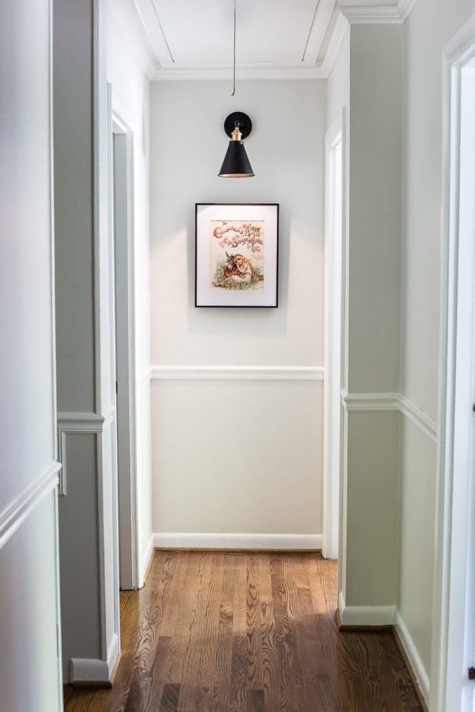 Simple Thermostat Cover and Hallway Progress | A dark, beige hallway gets a light and bright makeover, plus a solution for creating an inexpensive thermostat cover and sconce lighting without the electrical work. #thermostatcover #hallway #hallwaymakeover #beforeandafter #sconce #sconcelight #walldecor #wallart #budgetdecor #freeart #decortrick #eyesorecover Hallway Sconce Light