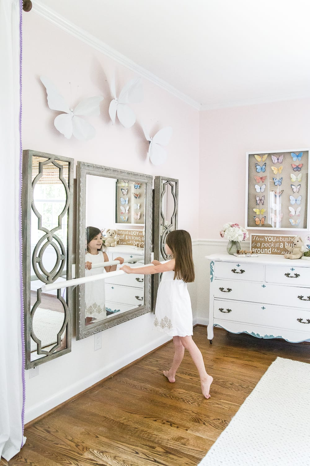 kid-friendly home - DIY ballet barre in a girl's bedroom