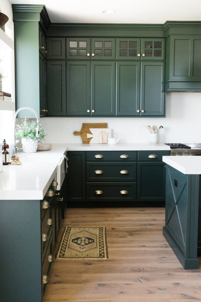 painting kitchen cabinet white in the green wall | Green Kitchen Cabinet Inspiration - Bless'er House