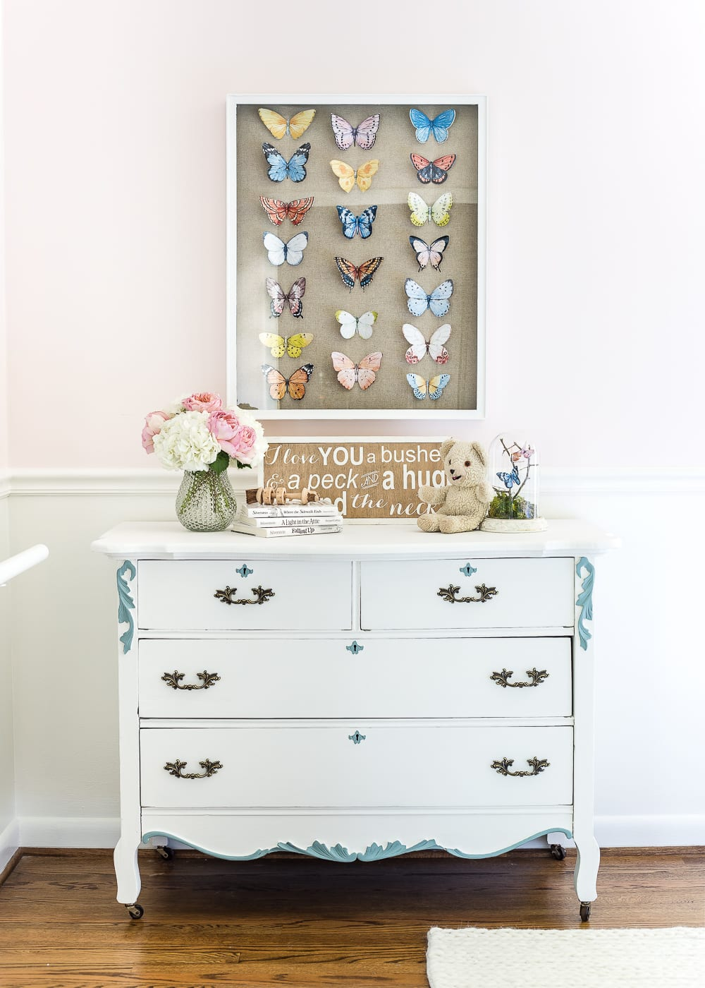 A tutorial about how to make an inexpensive modern Victorian style butterfly study shadow box with free printables of watercolor butterfly graphics for a little girl bedroom. #kidsdecor #girlbedroom #girlroom #kidsbedroom #wallart #kidsart #kidswallart #butterfly #butterflies #butterflydecor #girlydecor #nursery