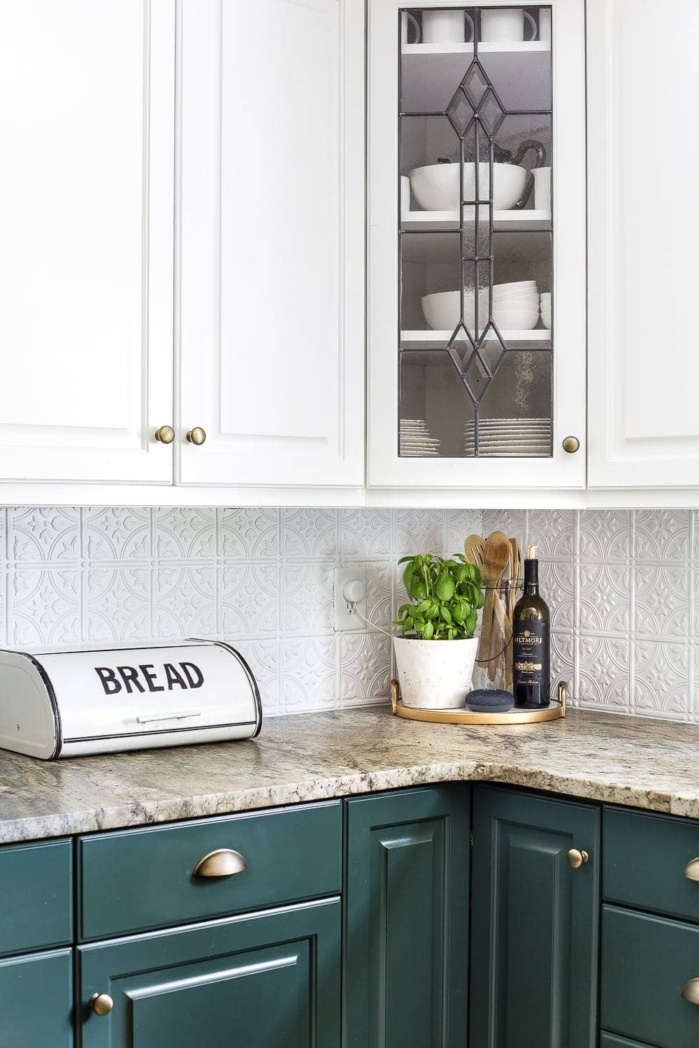 budget kitchen refresh reveal with two tone deep green cabinets, leathered granite, and pressed ceiling tile backsplash