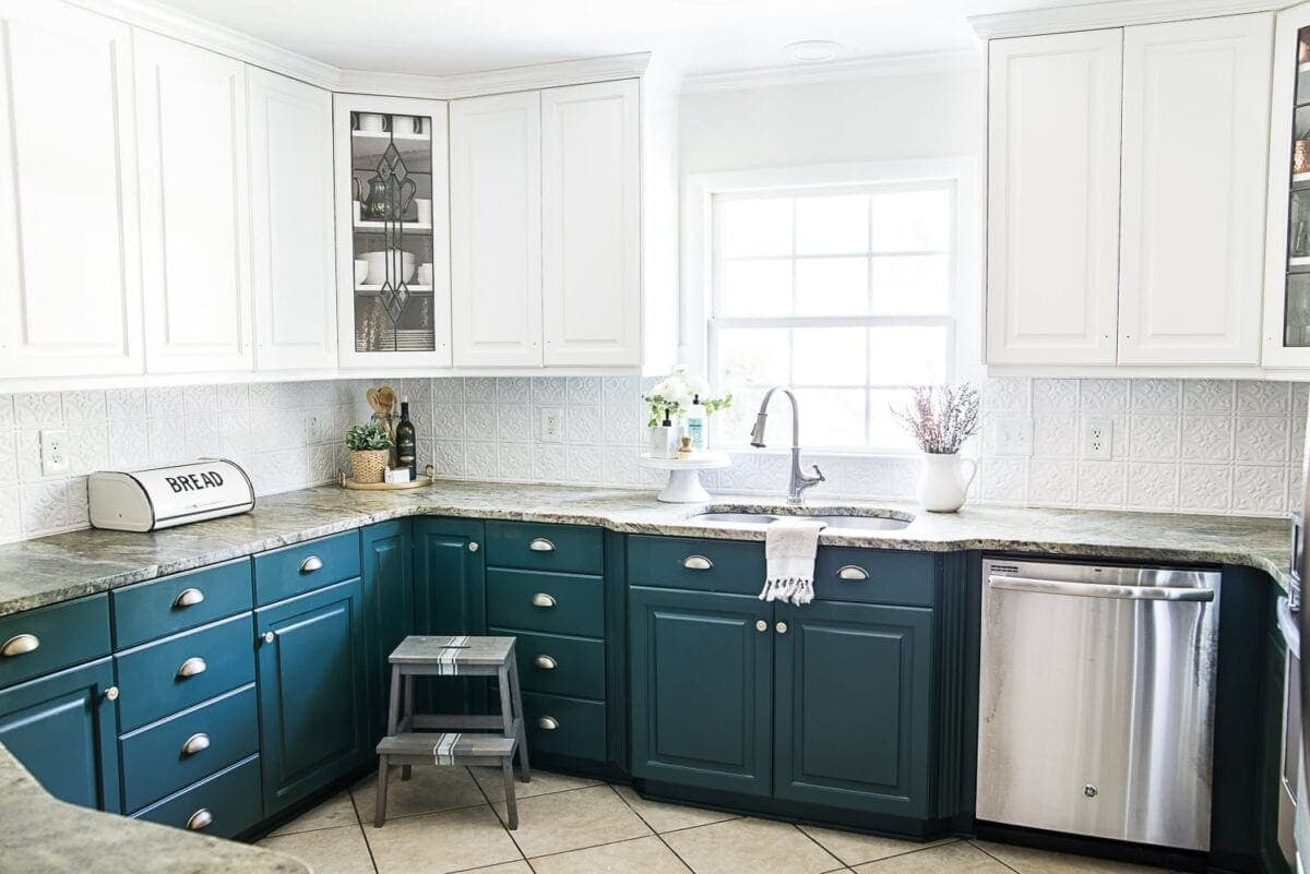 white upper cabinets and green lower cabinets in the color Benjamin Moore Simply White and Sherwin Williams Billiard Green