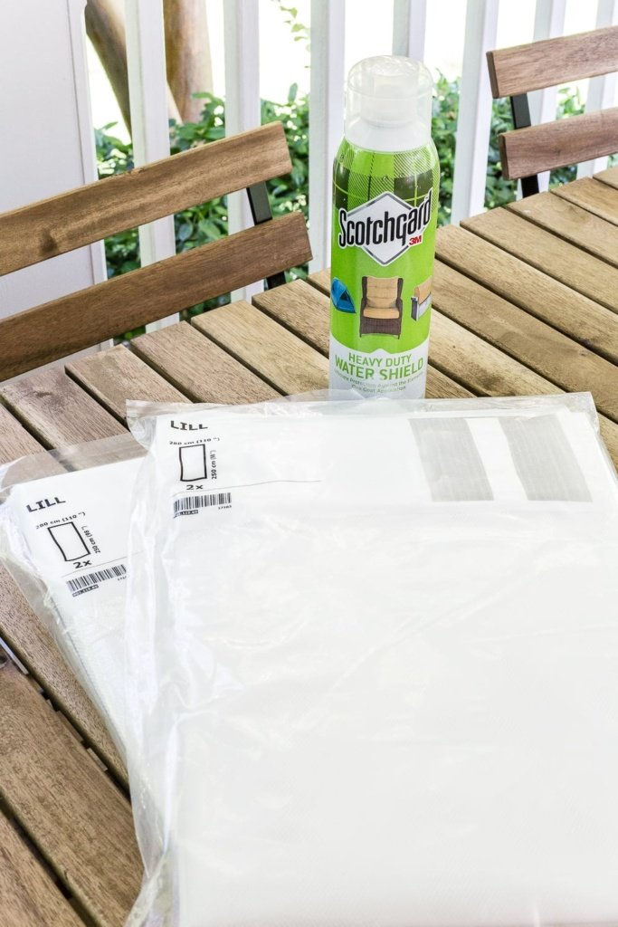 DIY outdoor curtains using Scotchgard to weather-proof them