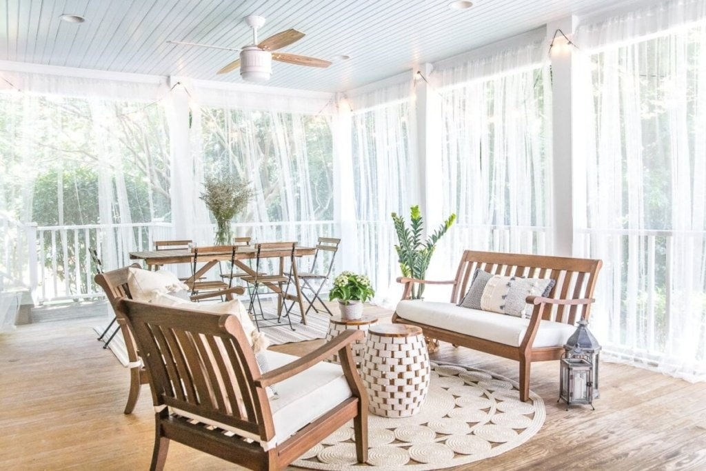 screened porch with DIY outdoor curtains