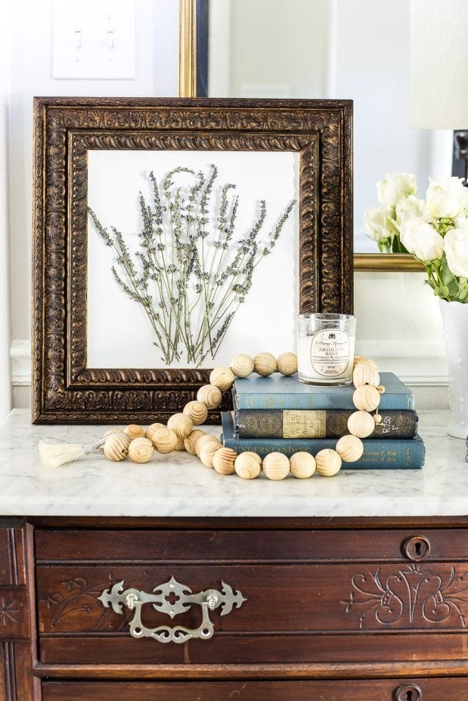 must-have thrift store staple : old frames transformed using aging wax and DIY art