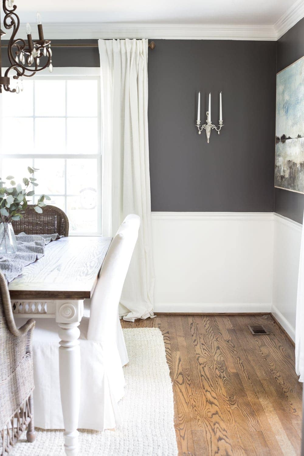 Benjamin Moore Kendall Charcoal dining room with French sconce