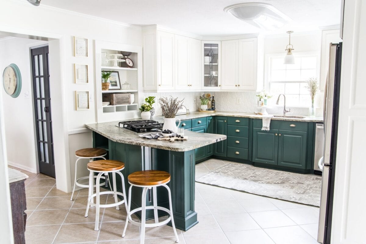 after kitchen refresh reveal with a high contrast modern look using deep green cabinets