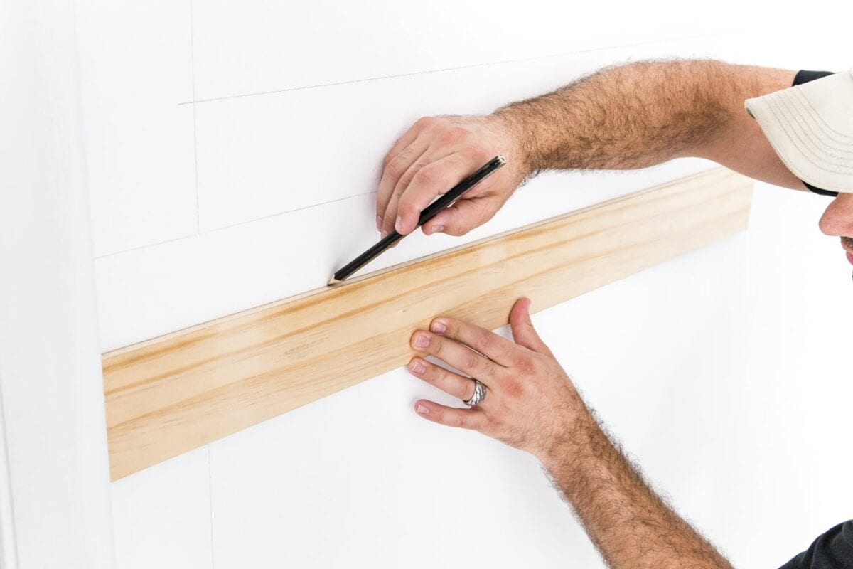 "Use a 3/8"" x 4"" board as a spacer to mark picture frame molding"