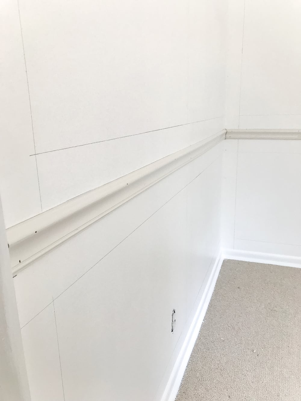 "mark walls for picture frame molding using a 4"" board as a spacer"