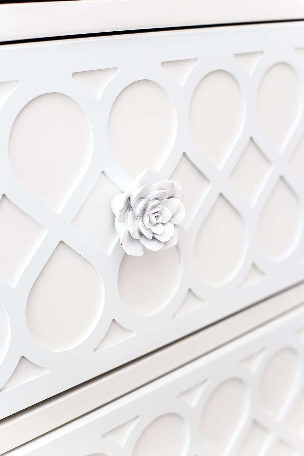 white cactus flower knobs and applique on a plain IKEA dresser