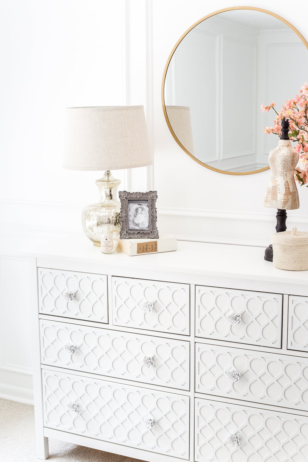 High-end designer knock-off dresser using a plain IKEA dresser and Hobby Lobby knobs with O'verlays appliques