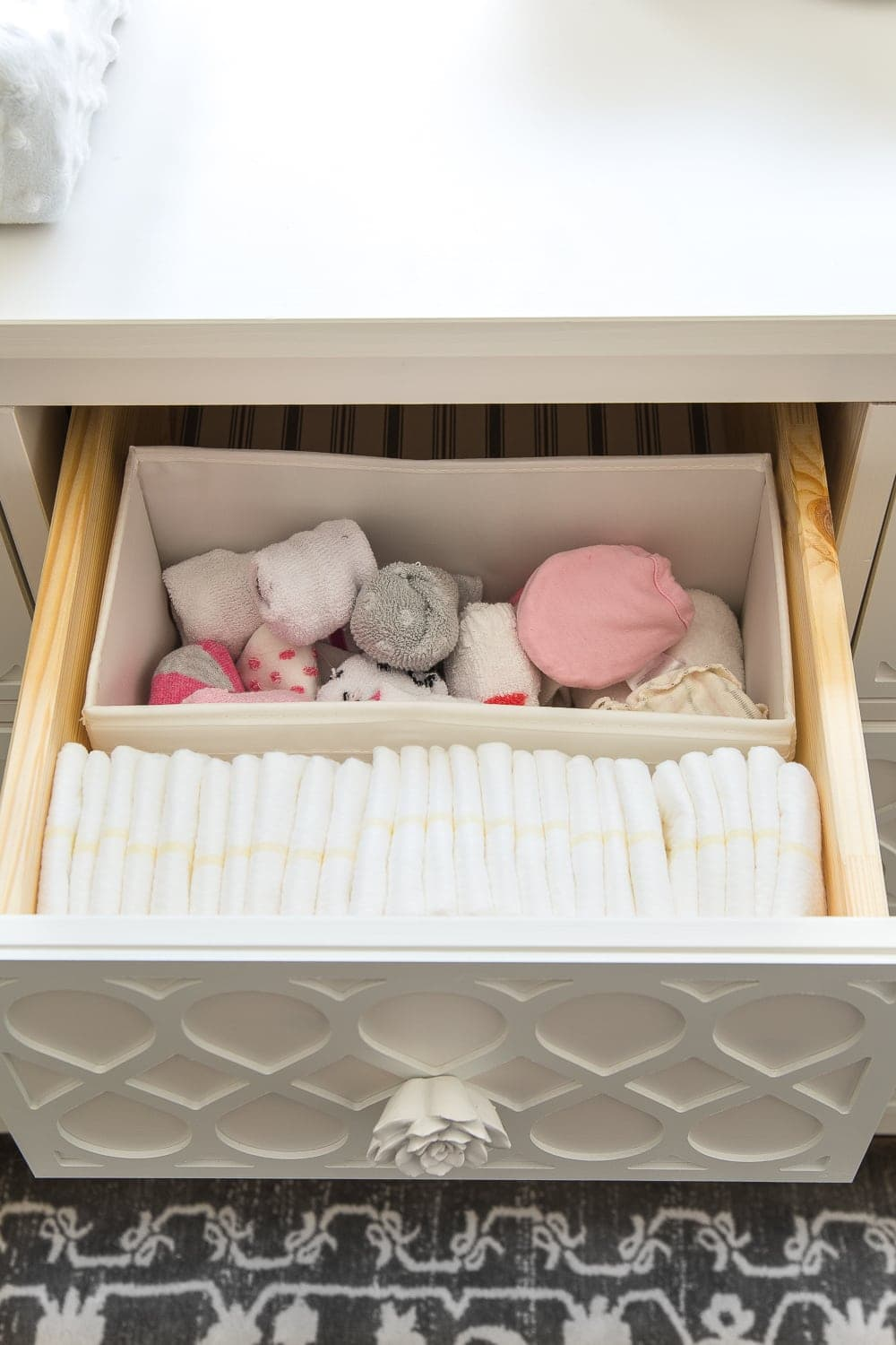 Nursery Organization | Dresser drawers with dividers to store diapers, socks, and mittens
