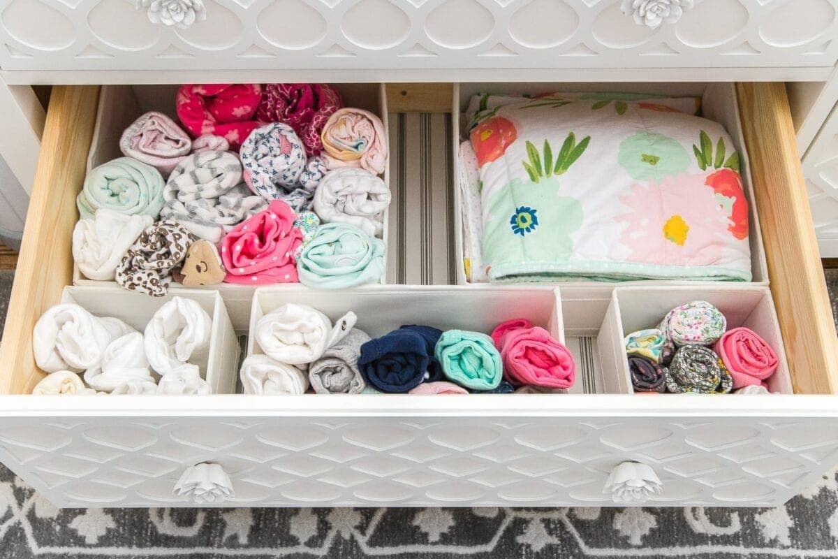 Nursery Organization | Dresser drawers with dividers to store clothing in categories.