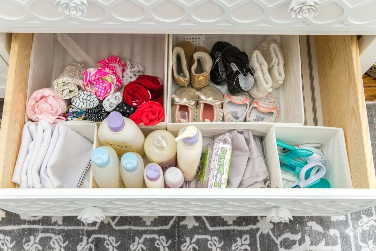 Nursery Organization | Dresser drawers with dividers to store baby soap, grooming kit, changing pads, shoes, and diaper pail bags.