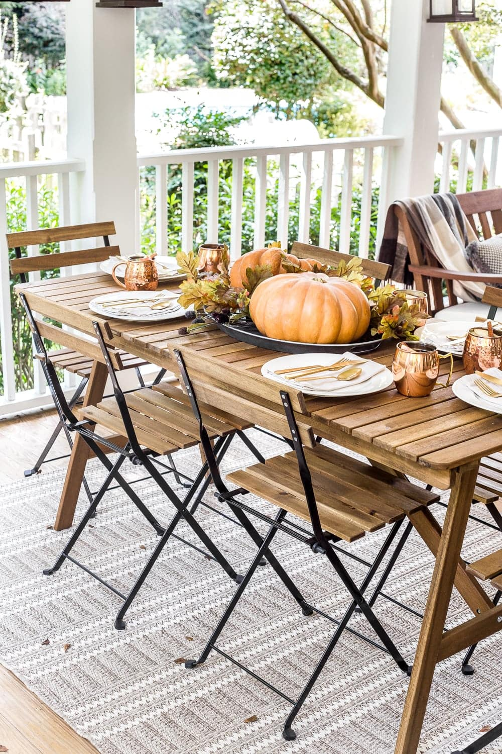 Cozy fall back porch outdoor entertaining dining